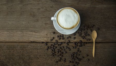 Coffee beans and coffee cup with coffee and coffee...