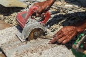 Workers are using stone cutting tools to use the cooling water.
