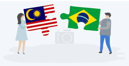 Couple holding two puzzles pieces with Malaysian and Brazilian flags. Malaysia and Brazil national symbols together.