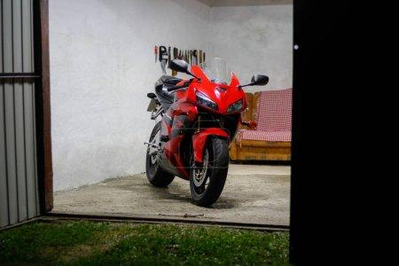 Photo for KRASNOYARSK, RUSSIA - August 16, 2018: Red and black sportbike Honda CBR 600 RR 2005 PC37 in garage - Royalty Free Image