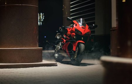 Photo for KRASNOYARSK, RUSSIA - September 23, 2019: Red and black sportbike Honda CBR 600 RR 2005 PC37 on the track at night. Light effect. - Royalty Free Image