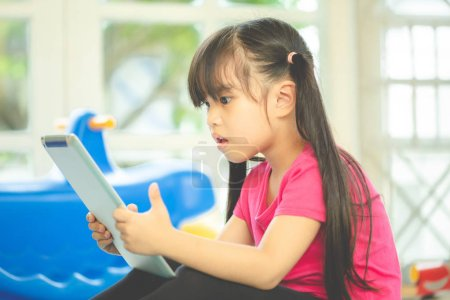 Photo for Asian girl using tablet , early education and learning - Royalty Free Image