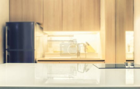 Photo for White glossy counter top and blur kitchen room background - Royalty Free Image
