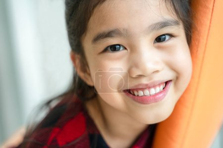 Photo for Asian  little girl  smiling with perfect smile and white teeth in dental care - Royalty Free Image