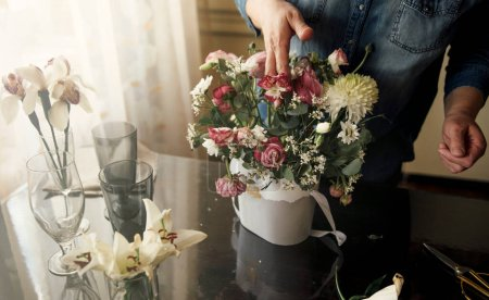 Photo for Girl collects a bouquet for a gift - Royalty Free Image