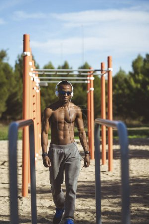 Photo for A male athlete training outdoors. - Royalty Free Image