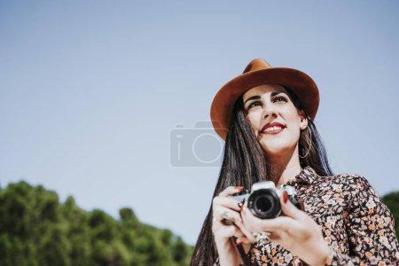 Photo for Female photographer holding an old analog camera - Royalty Free Image