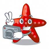 Photographer red starfish in the cartoon shape