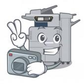 Photographer copier machine above mascot wood table