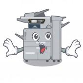 Surprised copier machine above mascot wood table
