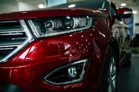 close up view of row new car design at dealership indoors