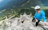 two young attractive mountain climbers on very exposed Via Ferrata in Alta Badia in the Italian Dolomites