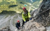 two young attractive female mountain climber in the Dolomites of italy with a great panorama view