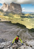 young attractive female mountain climber in the Dolomites of italy with a great  view