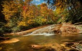 Sliding Rock Falls in the Appalachians of North Carolina in late autumn with fall color foliage