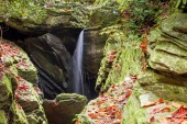 Duggers Creek Falls  waterfall in a narrow rocky gorge in the North Carolina mountains in autumn near Linville