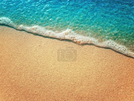 Photo for Sand and water texture background. Soft sea foam wave on the golden sandy beach. - Royalty Free Image