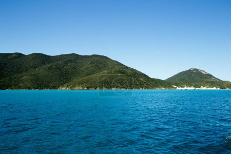 Photo for Seascape with clear blue sea, green mountains and serene sky - Royalty Free Image