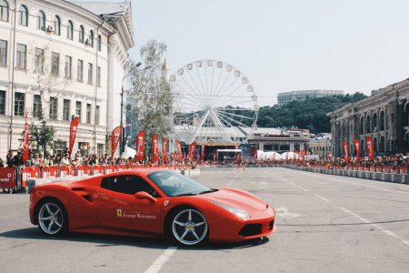 red Ferrari car in city