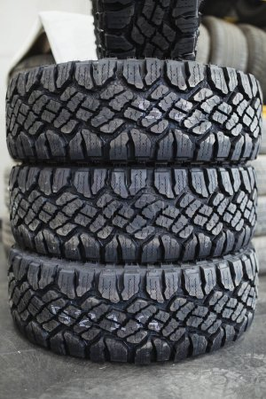 Stacked new car tires in car wheels shop