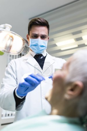 Photo for Dentist and patient in dental clinic - Royalty Free Image
