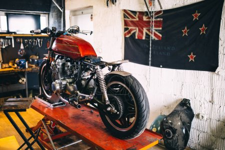 old custom motorcycle in repair garage