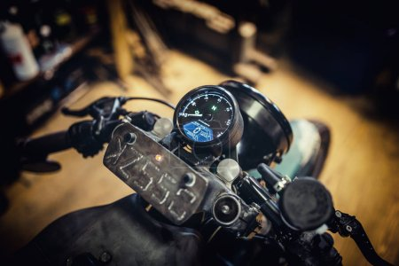 Close up details of speedometer of custom made motorcycle.