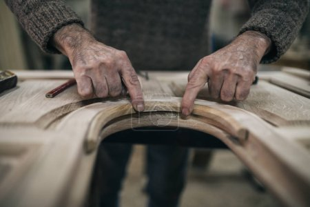 Photo for Close up shot of old master carpenter working in his woodwork or workshop - Royalty Free Image