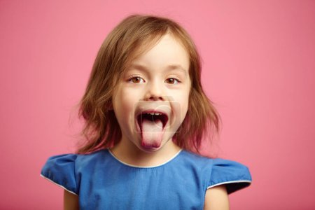 Isolated portrait of kid girl with wide open mouth...