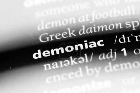 Demoniac word in a dictionary. demoniac concept...