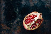 Top view of pomegranate quarter, juicy and sweet
