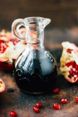 Glass jar filled by fresh pomegranate sauce