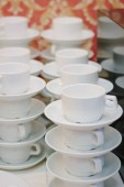 Lot of coffee cups at restaurant or cafe.