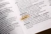 The word or phrase Acerbic in a dictionary highlighted with marker.