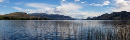 Beautiful panoramic view of Osoyoos Lake in British Columbia, Canada. Taken during a cloudy summer day.