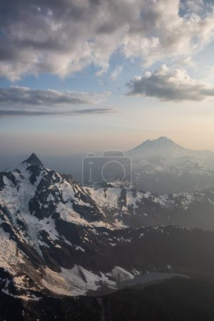 Aerial landscape view of the rugged mountain peaks with Mount Baker in the background. Located Northeast of Seattle, Washington, United States of America.