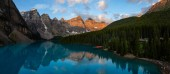 Beautiful Panoramic view of an Iconic Famous Place, Moraine Lake, during a vibrant summer sunrise. Located in Banff National Park, Alberta, Canada.