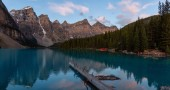 Beautiful view of an Iconic Famous Place, Moraine Lake, during a vibrant summer sunrise. Located in Banff National Park, Alberta, Canada.
