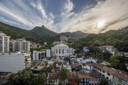 Beautiful sunset landscape in Cosme Velho, with a view to the city, the rainforest and Corcovado Mountain, Rio de Janeiro, Brazil