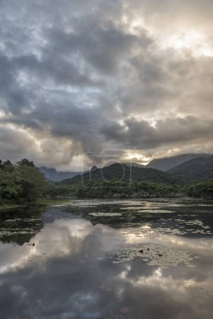 Beautiful lake with mountains and wild natural landscape, Atlantic Rainforest ecological reserve in the countryside of Rio de Janeiro near Guapiacu, Brazil