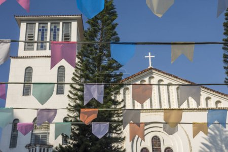 Typical decoration with colorful flags in front church, Laranjeiras, Rio de Janeiro