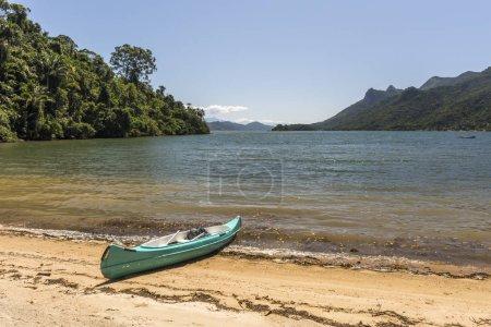 Beautiful tropical landscape with ocean kayak and green rainforest in Saco do Mamangua, Paraty, Costa Verde region in south Rio de Janeiro, Brazil