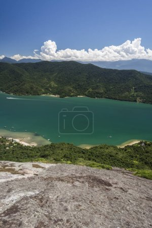 View from mountain top to beautiful landscape with green rainforest and blue ocean in tropical Saco do Mamangua, Paraty, Costa Verde region in south Rio de Janeiro, Brazil