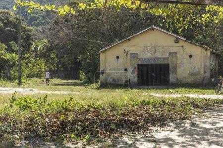 Photo for Landscape of abandoned wharehouse on the beachfront in Vila Dois Rios, a small village behind Dois Rios Beach, Ilha Grande, Costa Verde, south Rio de Janeiro, Brazil - Royalty Free Image