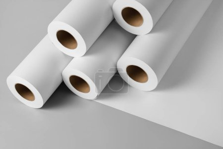 Blank white paper rolls isolated on gray backgroun...