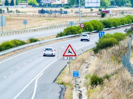 Cars on road, Nuevo Naharros, Salamanca, Spain...