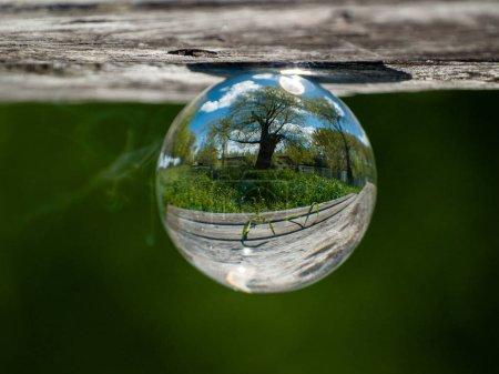 Foto de Reflections of clear sky in a crystal ball - Imagen libre de derechos