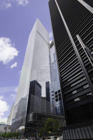 Glass skyscrapers in financial district over blue sky in New York City