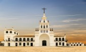 El Rocio hermitage in a cloudy day at small village with the same name in Almonte, Huelva, Andalusia, Spain