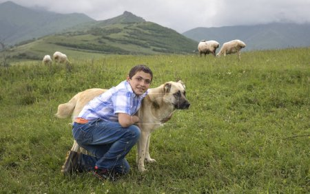 Tatev, Armenia, 1st June, 2018: armenian boy with his dog in a countryside
